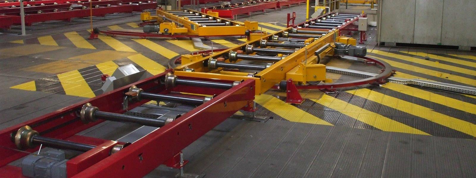 Manutention de skid dans un atelier de peinture automobile chez Renault Sandouville avec des tables à galet ATS Group, Appalette Tourtellier Systèmes, ATS Conveyors India, HERO Fördertechnik