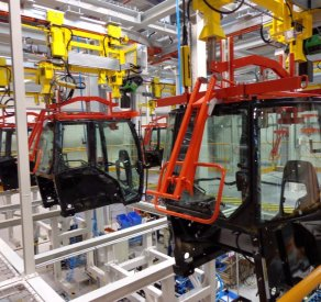 AGCO tractor cabin assembly in France equipped with EMS (Electro Monorail System) transport unit with integrated lifting system ATS Group Appalette Tourtellier ATS Conveyors India HERO Fördertechnik